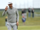 Dustin Johnson of the United States salutes the crowd on the 15th green during the first round of the 144th Open Championship at The Old Course on July 16, 2015