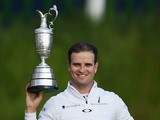 Zach Johnson holds the Claret Jug aloft after winning The Open at St Andrews on July 20, 2015