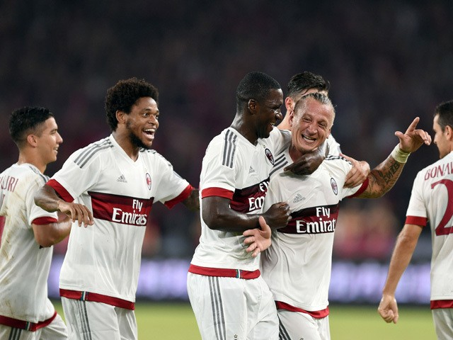 AC Milan's French defender Philippe Mexes celebrates with team mates after scoring a goal during the International Champions Cup football match between AC Milan and Inter Milan in Shenzhen on July 25, 2015