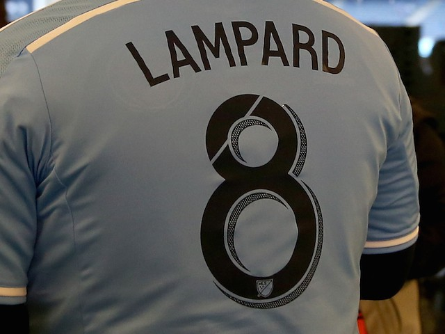 Fans wear Frank Lampard's jersey before the inaugural game of the New York City FC as they play the New England Revolution at Yankee Stadium on March 15, 2015