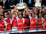 Captain Mikel Arteta of Arsenal lifts the trophy after their 1-0 win in the FA Community Shield match between Chelsea and Arsenal at Wembley Stadium on August 2, 2015