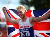 Jonnie Peacock of Great Britain celebrates after winning mens 100m T44 final during day one of the IPC Athletics European Championships at Swansea University Sports Village on August 19, 2014