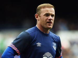 Manchester United's former Everton forward Wayne Rooney warms up ahead of the Duncan Ferguson Testimonal pre-season friendly football match between Everton and Villarreal at Goodison Park in Liverpool, north west England on August 2, 2015