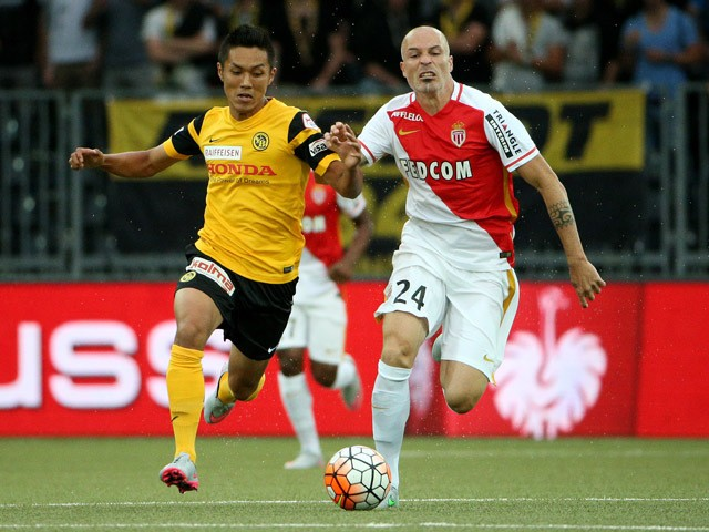 Yuya Kubo of BSC Young Boys (L) competes for the ball with Andrea Raggi of AS Monaco during the UEFA Champions League third qualifying round 1st leg match between BSC Young Boys and AS Monaco at Stade de Suisse on July 28, 2015