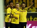 Dortmund's midfielder Ilkay Guendogan (R), Dortmund's striker Marco Reus (C) and Dortmund's Gabonese striker Pierre-Emerick Aubameyang celebrate after Reus scored during the UEFA Europa League third qualifying round second leg football match between Borus