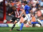 Konstantin Kerschbaumer of Brentford and Cole Skuse of Ipswich Town in action during the Sky Bet Championship match between Brentford and Ipswich Town at Griffin Park on August 8, 2015