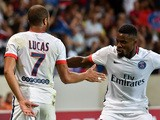 Paris Saint-Germain's Brazilian midfielder Lucas celebrates his goal with teammate French defender Serge Aurier during the French L1 football match between Lille and PSG on August 7, 2015