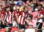 James Tarkowski (2nd R) of Brentford celebrates scoring his side's second goal during the Sky Bet Championship match between Brentford and Ipswich Town at Griffin Park on August 8, 2015