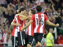 Athletic Bilbao's defender Mikel San Jose is congratulated by teammates midfielder Benat Etxebarria (L), midfielder Oscar de Marcos (3rd L) and defender Xabier Etxeita (R) after scoring during the Spanish Supercup first-leg football match Athletic Club Bi