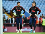 Sergio Romero of Manchester United with Sam Johnstone of Manchester United prior to the Barclays Premier League match between Aston Villa and Manchester United on August 14, 2015