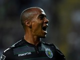 Sporting's forward Joao Mario celebrates after scoring the opening goal during the Portuguese Liga football match CD Tondela vs SC Sporting at the Aveiro City stadium in Aveiro on August 14, 2015