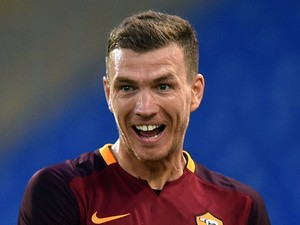 Roma's Bosnian forward Edin Dzeko celebrates after scoring during the friendly football match between Roma and Valencia at the Olympic stadium in Rome on August 14, 2015