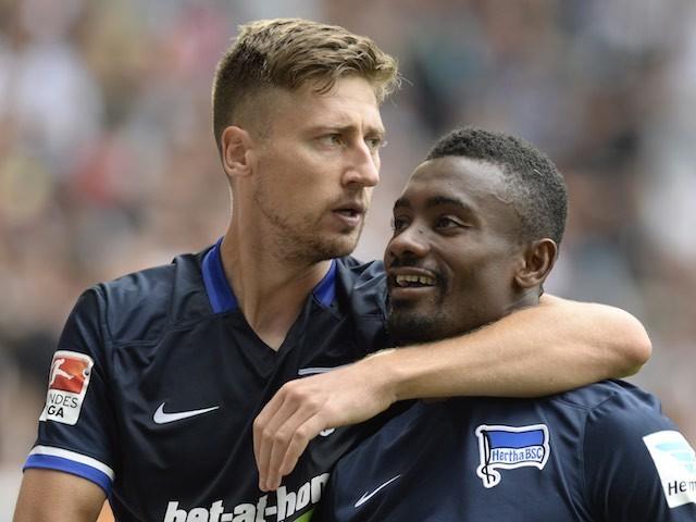 Jens Hegeler congratulates Salomon Kalou after he scores a penalty for Hertha Berlin against Augsburg on August 15, 2015