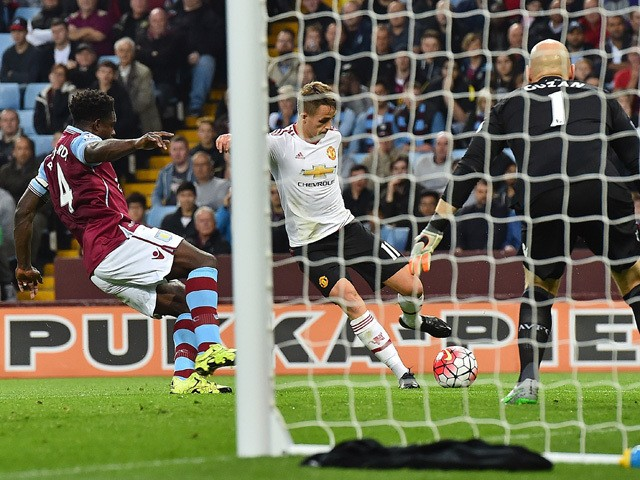 Manchester United's Belgian midfielder Adnan Januzaj scores his team's first goal during the English Premier League football match between Aston Villa and Manchester United at Villa Park in Birmingham, central England, on August 14, 2015