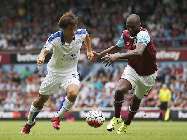 Leicester's Shinji Okazaki takes on Angelo Ogbonna of West Ham on August 15, 2015