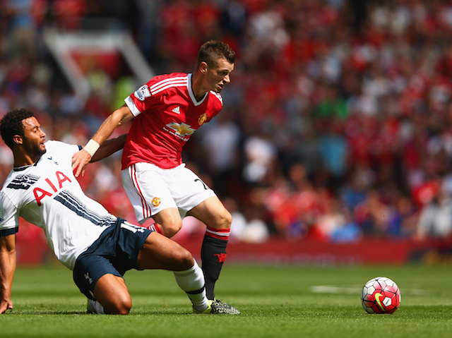 Morgan Schneiderlin of Manchester United and Mousa Dembele of Tottenham Hotspur compete for the ball during the Barclays Premier League match between Manchester United and Tottenham Hotspur at Old Trafford on August 8, 2015 in Manchester, England.