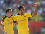 Dortmund's midfielder Jonas Hofmann and Dortmund's Gabonese striker Pierre-Emerick Aubameyang celebrate after the fourth goal for Dortmund during the German first division Bundesliga match between FC Ingolstadt and Borussia Dortmund in the stadium in Ingo