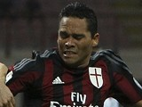 Carlos Bacca (R) of AC Milan is challenged by Massimo Volta (L) of AC Perugia during the TIM Cup match between AC Milan and AC Perugia at Stadio Giuseppe Meazza on August 17, 2015