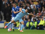 Everton's English defender Phil Jagielka vies with Manchester City's Argentinian striker Sergio Aguero during the English Premier League football match between Everton and Manchester City at Goodison Park in Liverpool on August 23, 2015