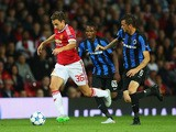 Matteo Darmian of Manchester United goes past Claudemir of Club Brugge during the UEFA Champions League Qualifying Round Play Off First Leg match between Manchester United and Club Brugge at Old Trafford on August 18, 2015