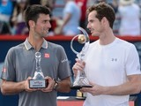 Novak Djokovic and Andy Murray pose with their trophies after the Rogers Cup on August 16, 2015
