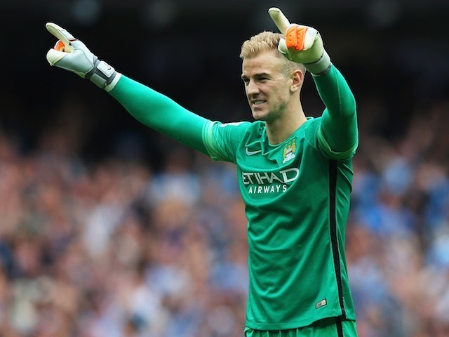 Man City keeper Joe Hart celebrates his side's second goal against Chelsea