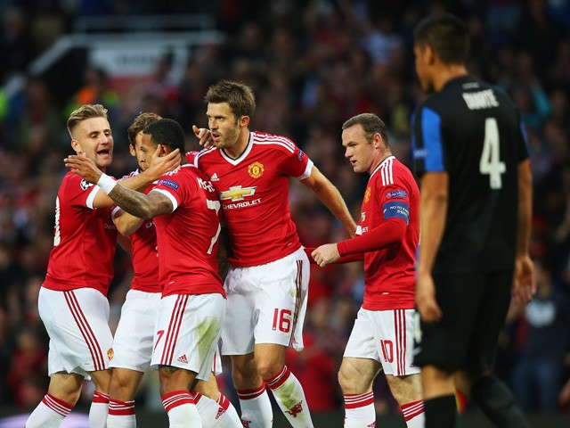 Memphis Depay of Manchester United celebrates scoring his team's opening goal with team mates during the UEFA Champions League Qualifying Round Play Off First Leg match between Manchester United and Club Brugge at Old Trafford on August 18, 2015