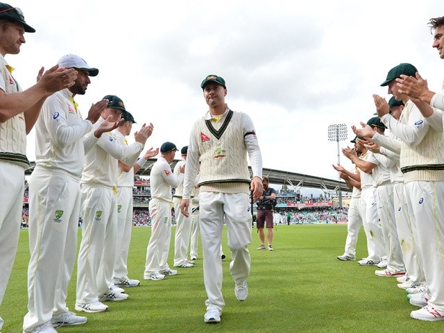 Australia's captain Michael Clarke receives a guard of honour from his Australia teammates as he leaves the field after Australia wrap up the game on the fourth day of the fifth Ashes cricket test match between England and Australia at The Oval cricket gr