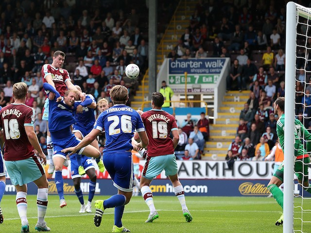 Michael Keane of Burnley scores the opening goal during the Sky Bet Championship match between Burnley and Brentford at Turf Moor on August 22, 2015