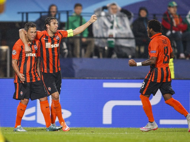 Players of Donetsk celebrate after scoring during the UEFA Champions League: Qualifying Round Play Off First Leg match between SK Rapid Vienna and FC Shakhtar Donetsk on August 19, 2015