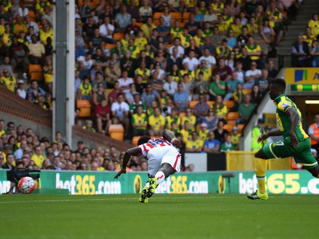 Mame Biram Diouf of Stoke City scores his team's first goal during the Barclays Premier League match between Norwich City and Stoke City at Carrow Road on August 22, 2015