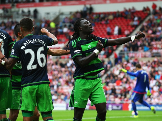 Bafetimbi Gomis (1st R) of Swansea City celebrates scoring his team's first goal during the Barclays Premier League match between Sunderland and Swansea City at the Stadium of Light on August 22, 2015