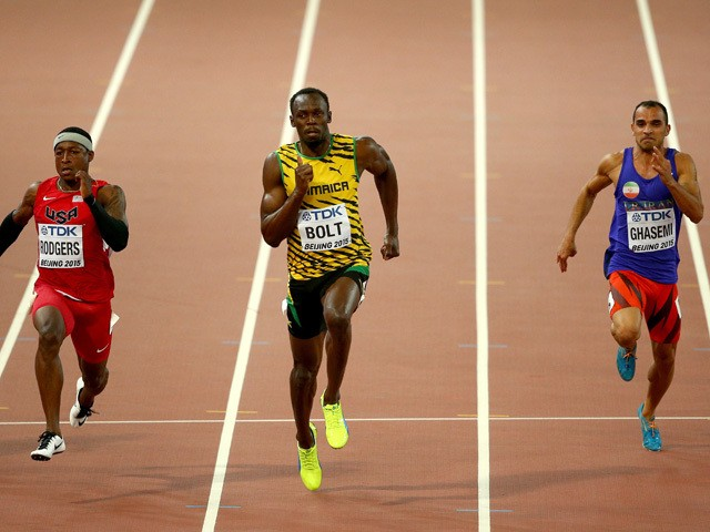 Mike Rodgers of the United States, Usain Bolt of Jamaica and Reza Ghasemi of Iran compete in the Men's 100 metres heats during day one of the 15th IAAF World Athletics Championships Beijing 2015 at Beijing National Stadium on August 22, 2015