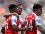 Alex Oxlade-Chamberlain, Nacho Monreal and Hector Bellerin of Arsenal celebrates their team's first goal scored by Fabricio Coloccini (not pictured) of Newcastle United during the Barclays Premier League match between Newcastle United and Arsenal at St Ja