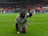 Swansea striker Bafetimbi Gomis celebrates after scor