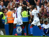 Bakary Sako of Crystal Palace celebrates scoring his team's first goal with his team mate Yannick Bolasie during the Barclays Premier League match between Chelsea and Crystal Palace at Stamford Bridge on August 29, 2015