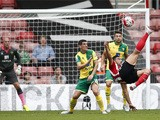 Southampton's Italian striker Graziano Pelle (R) tries an unsuccessful overhead shot during the English Premier League football match between Southampton and Norwich City at St Mary's Stadium in Southampton, southern