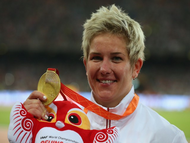 Gold medalist Anita Wlodarczyk of Poland poses on the podium during the medal ceremony for the Women's Hammer final during day six of the 15th IAAF World Athletics Championships Beijing 2015 at Beijing National Stadium on August 27, 2015