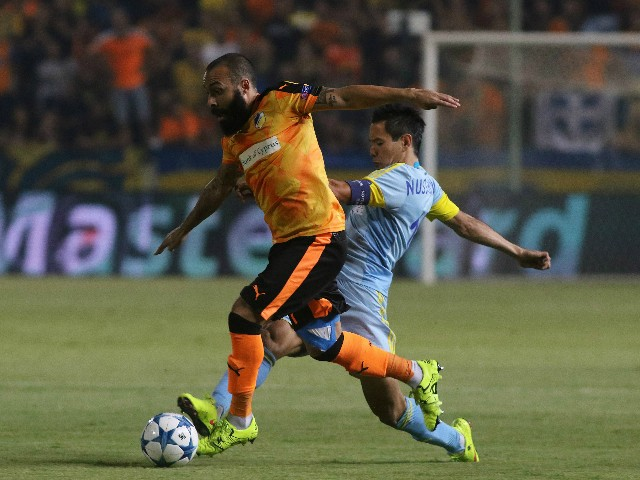 Apoel's Vander and FC Astana's Tanat Nuserbayev in action during UEFA Champions League play off between APOEL Nicosia and FC Astana at GSP Stadium on August 26, 2015 in Nicosia, Cyprus.