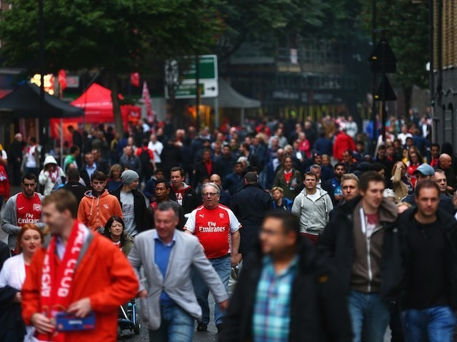 Arsenal and Liverpool fans arrive at the Emirates ahead of kickoff on August 24, 2015