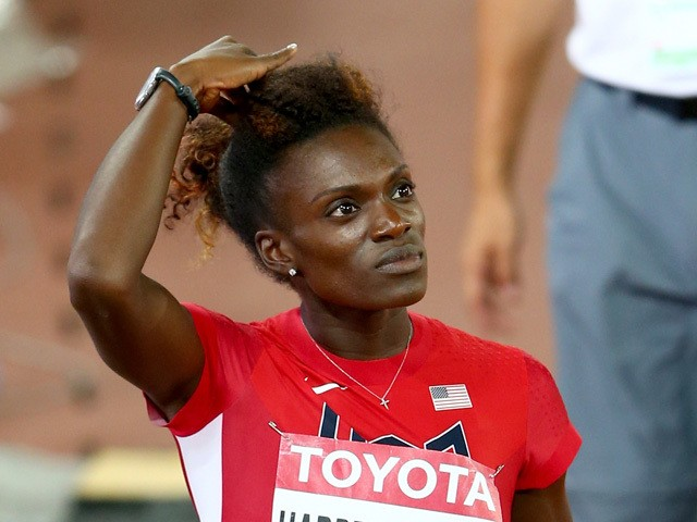 Dawn Harper Nelson of the United States reacts after falling during the Women's 100 metres hurdles semi-final during day seven of the 15th IAAF World Athletics Championships Beijing 2015 at Beijing National Stadium on August 28, 2015