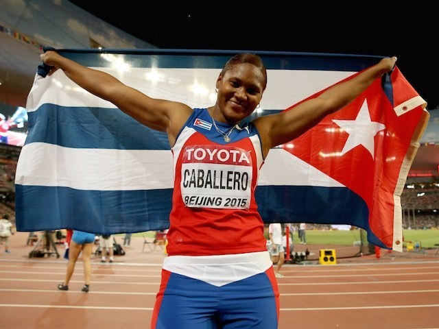 Cuba's Denia Caballero celebrates her discus triumph at the World Championships on August 25, 2015