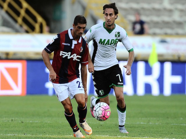 Franco Brienza # 23 of Bologna FC in action against Simone Missiroli of US Sassuolo Calcio during the Serie A match between Bologna FC and US Sassuolo Calcio at Stadio Renato Dall'Ara on August 29, 2015