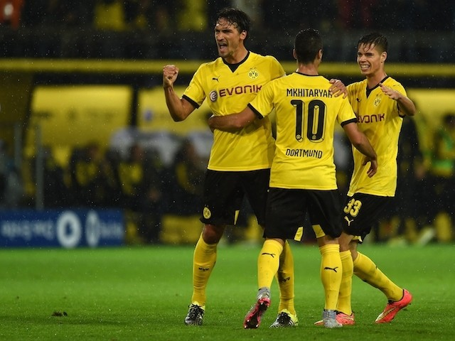 Dortmund's Henrikh Mkhitaryan, Mats Hummels and Julian Weigl celebrate during the UEFA Europa League second-leg play-off match between Borussia Dortmund and Odds BK in Dortmund on August 28, 2015