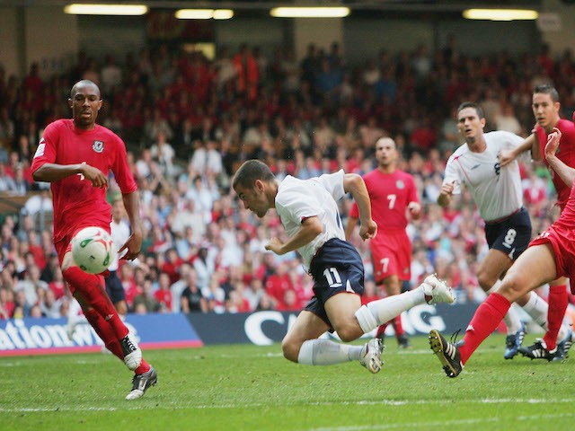 Joe Cole of England goes close to scoring a diving header during the 2006 World Cup Qualifying match between Wales and England at the Millennium Stadium on September 3, 2005