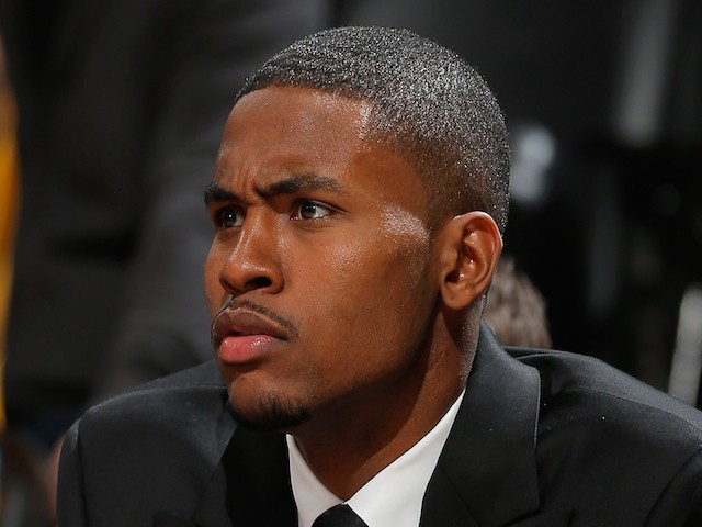 Maurice Harkless #21 of the Orlando Magic looks on from the bench against the Denver Nuggets at Pepsi Center on January 7, 2015