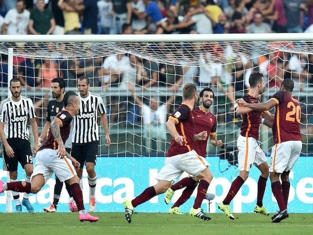 Roma's midfielder from Bosnia-Herzegovina Miralem Pjanic (2ndR) celebrates with teammates after scoring during the Italian Serie A football match AS Roma vs Juventus on August 30, 2015