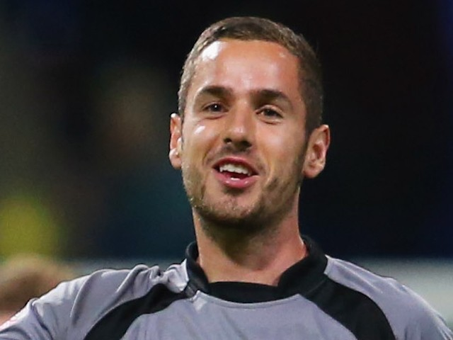 Remi Matthews of Burton Albion celebrate victory after the Capital One Cup first round match between Bolton Wanderers and Burton Albion at Macron Stadium on August 11, 2015