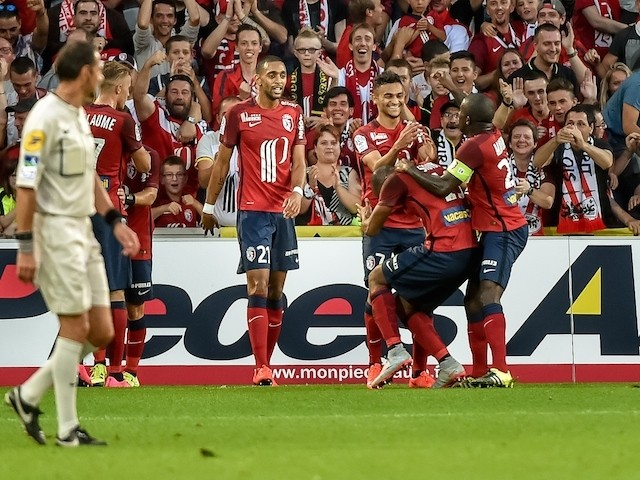 Lille's French midfielder Sofiane Boufal (C) is congratuled by his teammate after scoring a goal during the French L1 football match Lille vs Ajaccio on August 29, 2015