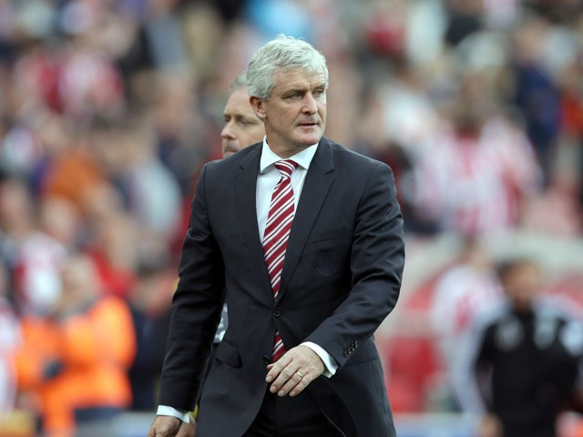 Mark Hughes manager of Stoke City leaves the pitch after the final whistle during the Barclays Premier League match between Stoke City and West Bromwich Albion at Britannia Stadium on August 29, 2015